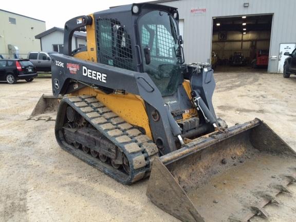 Detail photo of 2015 John Deere 329E from Construction Equipment Guide