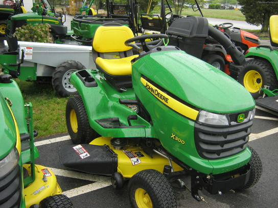 John Deere X300 Mulching Kit http://www.machinefinder.com/ww/en-US/machine/2619510