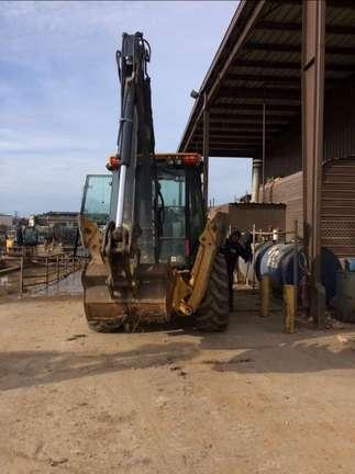 Detail photo of 2012 John Deere 410K from Construction Equipment Guide