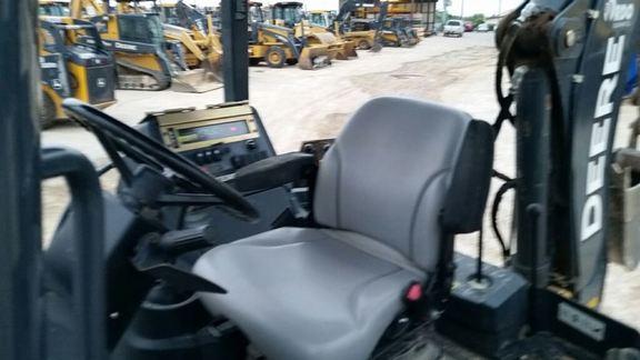 Detail photo of 2013 John Deere 310K from Construction Equipment Guide
