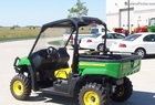 2012 John Deere XUV550 Gator, Green and Yellow, w/ roof, light,bumper, windshield, and rails...only 5 hours.