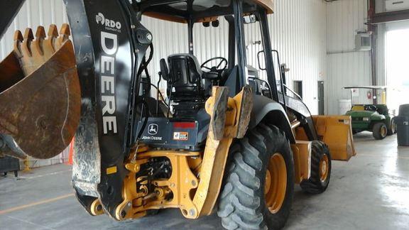 Detail photo of 2015 John Deere 310K from Construction Equipment Guide