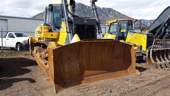 Detail photo of 2012 John Deere 1050J from Construction Equipment Guide