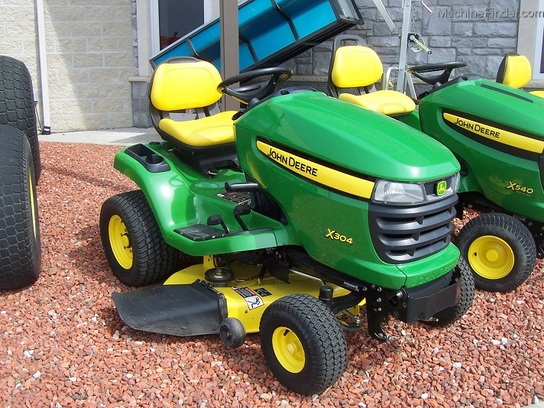 "2009 John Deere X304 Lawn Tractor with all-wheel-steer, and 42"" mower"
