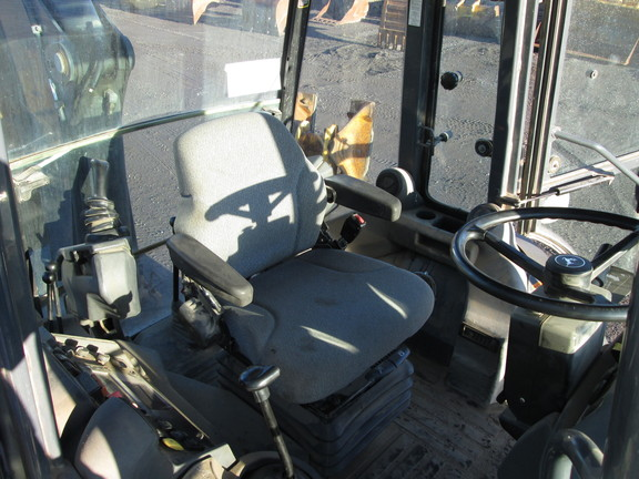 Detail photo of 2011 John Deere 310SJ from Construction Equipment Guide